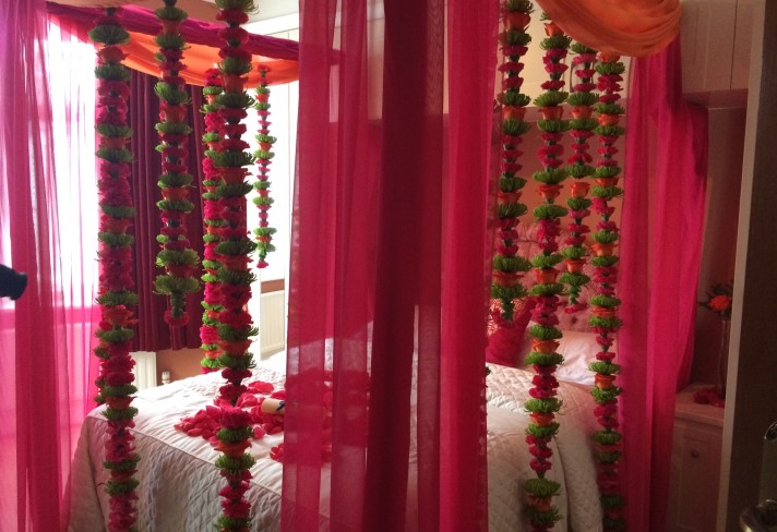 Dreamy first night bedroom design red pearl creations for Asian wedding bedroom decoration